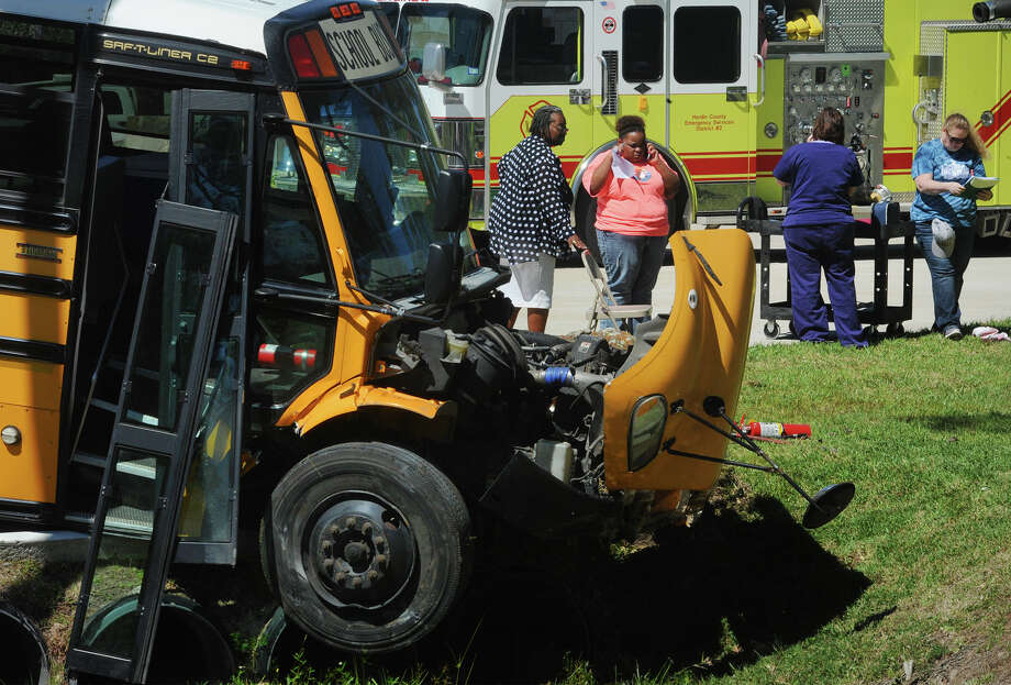 More than 20 Charlton-Pollard Elementary students and two adults were hospitalized when a Beaumont Independent School District bus was involved in a traffic accident on US 69 in Lumberton Wednesday. The bus was returning from a Big Thicket field trip when the accident forced the bus to crash into a culvert and stopping in another culvert several feet away. Lumberton Police are investigating the cause of the accident. Photo taken Wednesday, April 05, 2017 Guiseppe Barranco/The Enterprise Photo: Guiseppe Barranco, Guiseppe Barranco/The Enterprise