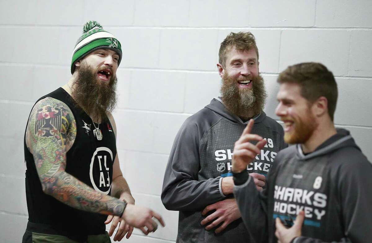 VANCOUVER, BC - FEBRUARY 2: Joe Thornton #19 of the San Jose Sharks looks on as teammate Brent Burns #88 yells at Joe Pavelski #8 during a soccer match before their NHL game against the Vancouver Canucks at Rogers Arena February 2, 2017 in Vancouver, British Columbia, Canada. (Photo by Jeff Vinnick/NHLI via Getty Images)