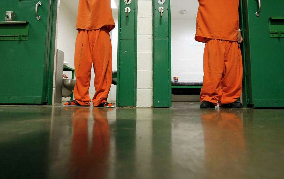 More than 77 percent of the Harris County jail population has not even been convicted of a crime. Four out of five people charged with a misdemeanor will spend time in jail. A quarter of those folks are not able to pay a $500 bond. (Chronicle File Photo) Photo: Johnny Hanson, Staff / © 2012  Houston Chronicle
