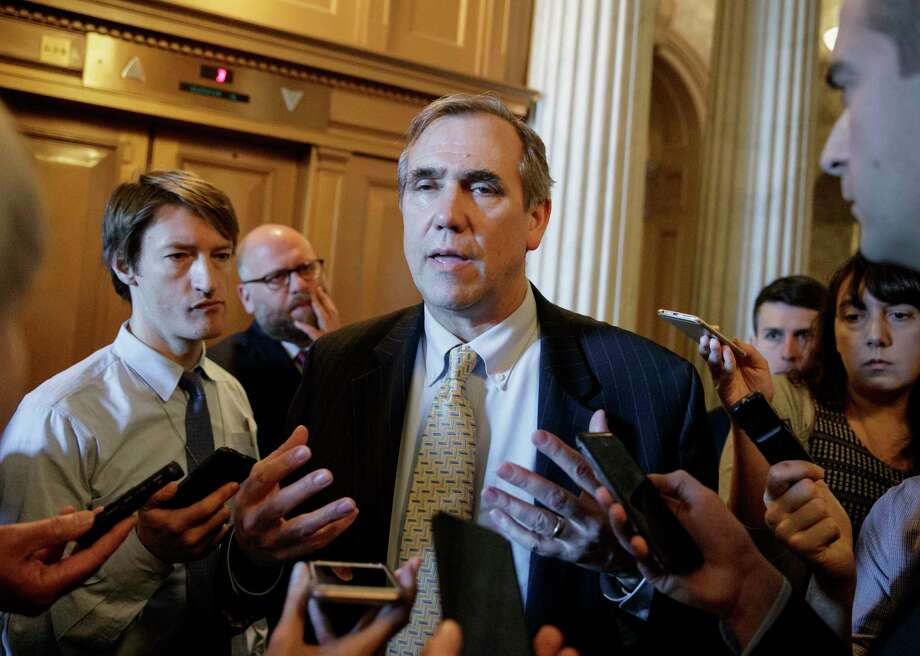 Sen. Jeff Merkley, D-Ore. speaks to reporters just outside the Senate chamber on Capitol Hill in Washington, Wednesday, April 5, 2017, after he ended a 15 hour all-night talk-a-thon as the Senate heads toward a showdown over the confirmation vote for Supreme Court Justice nominee Neil Gorsuch. (AP Photo/J. Scott Applewhite) Photo: J. Scott Applewhite, STF / Copyright: AP