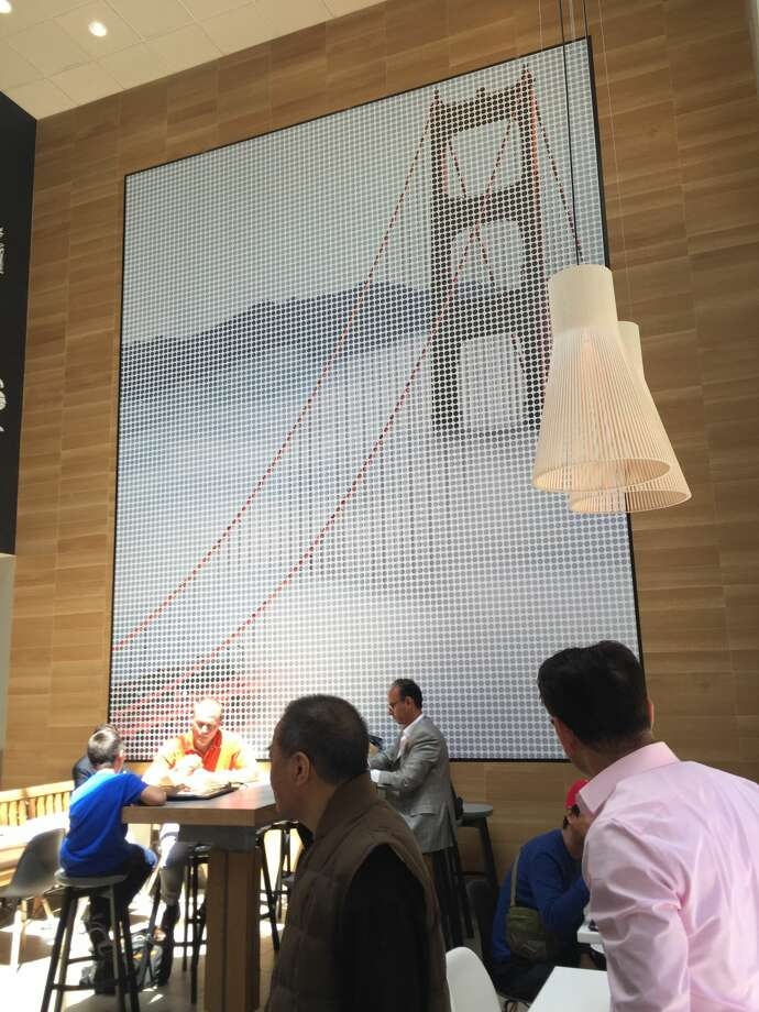 A large print of the Golden Gate Bridge graces the walls of McDonald's redesigned North Front Street location. Six of McDonald's 13 San Francisco outposts have been renovated, many featuring self-service kiosks, curbside delivery, and mobile ordering. Delivery will be rolled out as early as May. Photo: Courtesy McDonald's