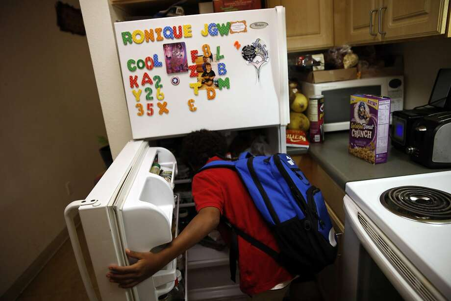 Before heading to school, Nicholas Gardner-Lewis, 8, makes breakfast. Photo: Scott Strazzante, The Chronicle