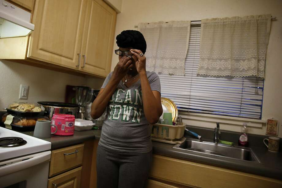 Nicole Gardner cries in the kitchen of her residence in Mill Valley. Photo: Scott Strazzante, The Chronicle
