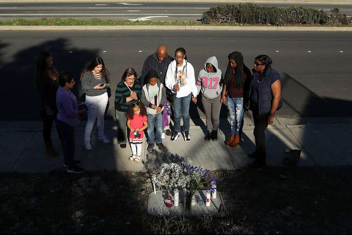 On Saturday, December 3, 2016, the one year anniversary of the shooting death of her daughter Ronique Gardner-Williams, Nicole Gardner-Lewis, her husband, Maurice, and children, Nicholas, 8, and Amauriana, 2, and others hold a candlelight vigil at the site of Ronique's murder along Hilltop Drive in Richmond, Calif..