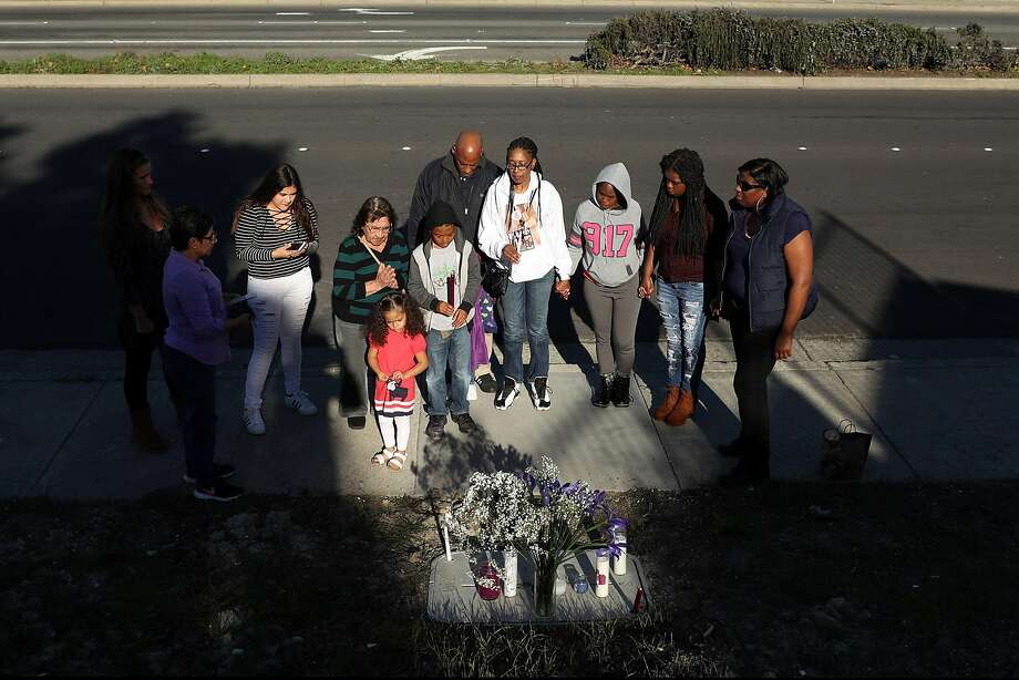 On the one year anniversary of the shooting death of her daughter Ronique Gardner-Williams, Nicole Gardner, her husband, Maurice, and children, Nicholas, 8, and Amauriana, 2, and others hold a candlelight vigil. Photo: Scott Strazzante, The Chronicle