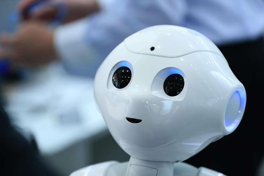 A Pepper humanoid robot, developed by Softbank Group Corp. Photo: Krisztian Bocsi, Bloomberg