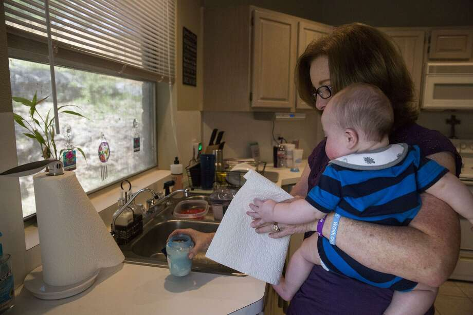 Kathy Friend, a therapeutic foster parent, prepares to feed an infant she is babysitting for another foster family at her home in San Antonio on March 24, 2017. Photo: Carolyn Van Houten /San Antonio Express-News / 2017 San Antonio Express-News