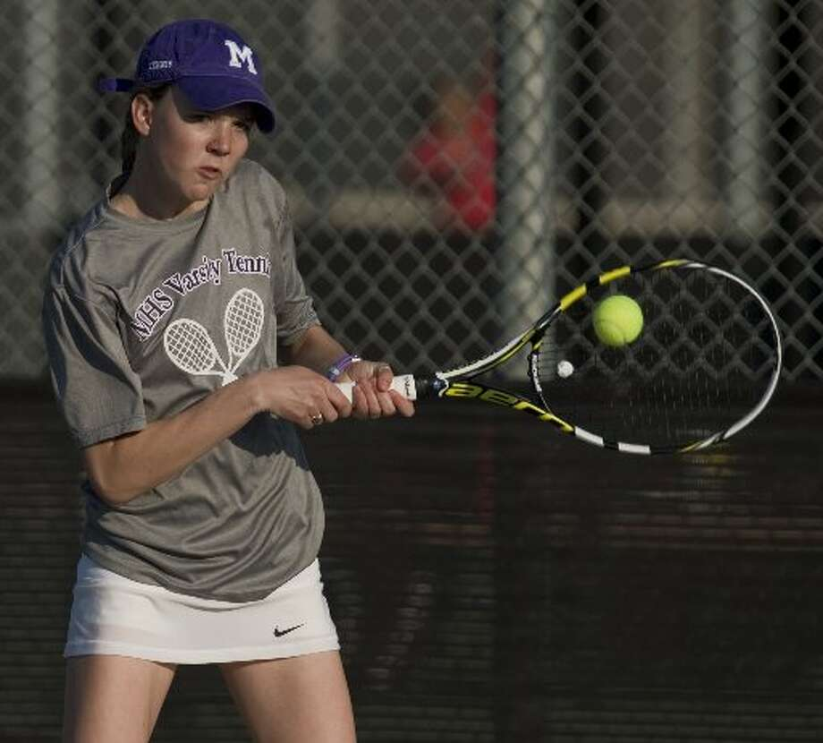 Midland High's Anna Parkison plays a match Friday 02-19-16 at Bush Tennis Center during the Tall City Invitational.Tim Fischer/Reporter-Telegram