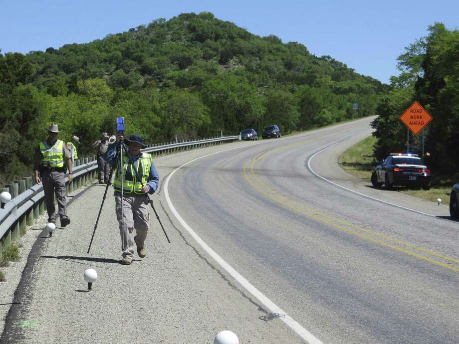 National Transportation Safety Board investigator Bob Squire sets up a 3-D laser scanner to digitally map the site on U.S. 83 in Uvalde County of a March 29, 2017 collision that killed 13 seniors from the First Baptist Church of New Braunfels. Photo: Zeke MacCormack, San Antonio Express-News / San Antonio Express-News / San Antonio Express-News