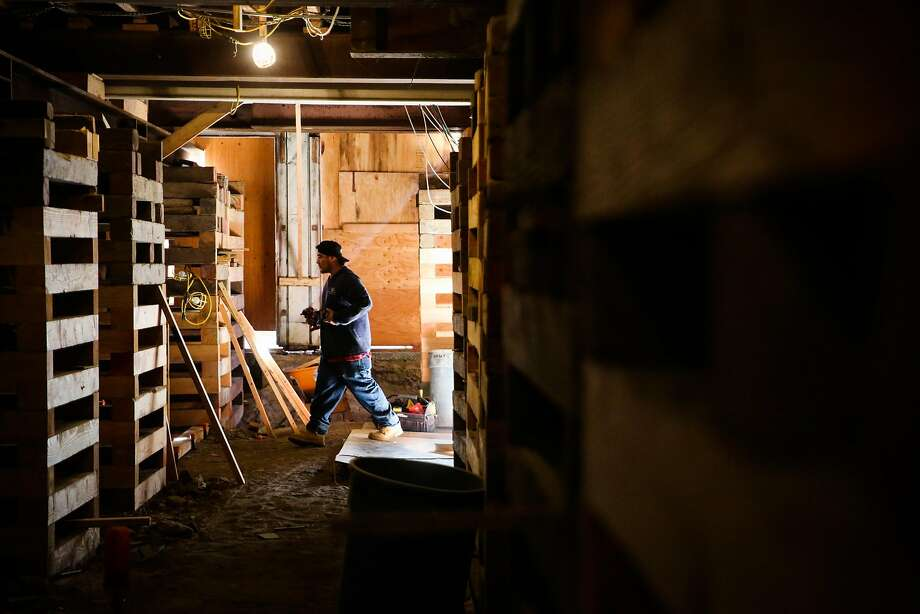 Rafael Bilchis, who works for Seismic Retrofitters, walks through the basement of a building while doing construction work in the Marina District in San Francisco, California, on Tuesday, March 28, 2017. Photo: Gabrielle Lurie, The Chronicle