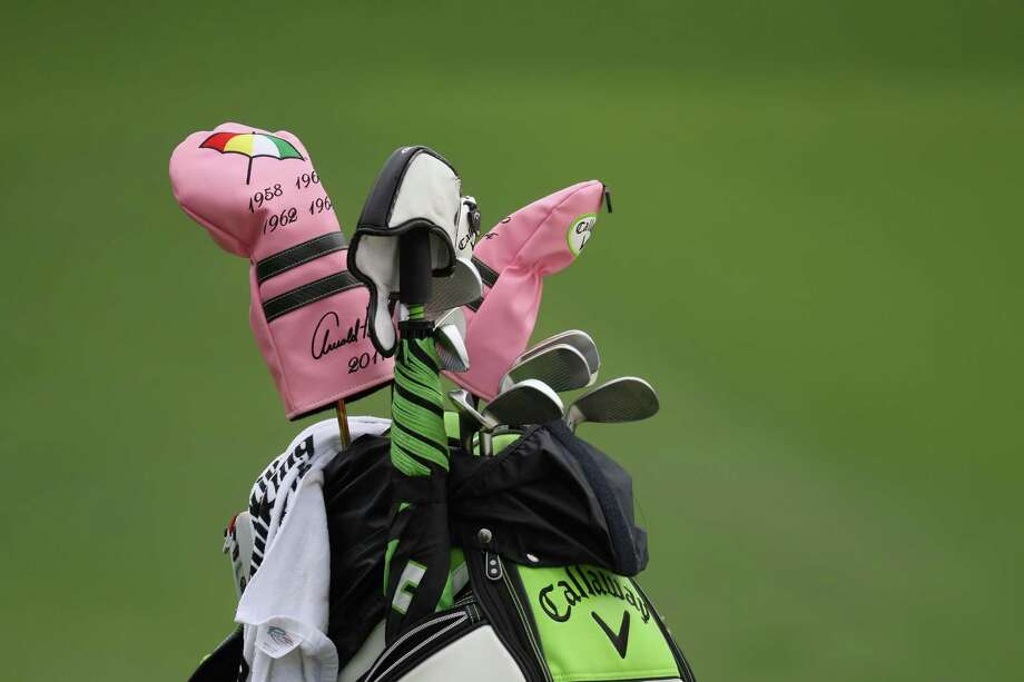 AUGUSTA, GA - APRIL 05:  Headcovers honoring Arnold Palmer and his Masters' wins are seen on the bag of Kevin Kisner of the United States during a practice round prior to the start of the 2017 Masters Tournament at Augusta National Golf Club on April 5, 2017 in Augusta, Georgia.  (Photo by Rob Carr/Getty Images) ORG XMIT: 692253961 Photo: Rob Carr / 2017 Getty Images
