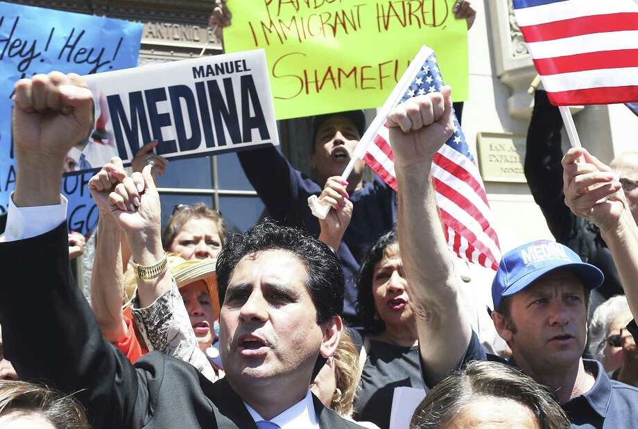 San Antonio mayoral hopeful Manuel Medina speaks to a crowd protesting in front of the San Antonio Express-News. At right in a cap is Rodkey Kidd. Photo: JERRY LARA / San Antonio Express-News / © 2017 San Antonio Express-News