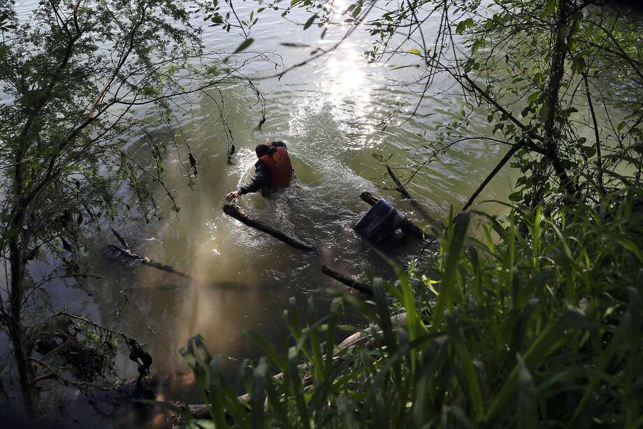 An undocumented immigrant wades across the Rio Grande at the U.S.-Mexico border on in March in Roma, Texas. Photo: John Moore, Getty Images