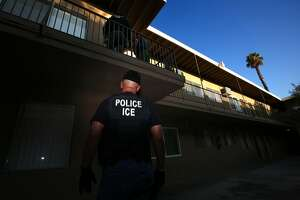 RIVERSIDE, CA - AUGUST 12: ICE Enforcement and Removal Operations unit raid to apprehend immigrants without any legal status and who may be deportable in Riverside. Immigration and Customs Enforcement officials say they are relying more than ever on costly manhunts to locate immigrants in the country illegally who have criminal records. In the past, the agency would simply contact local jails where such immigrants were being detained and ask jail officials to hold them until an ICE van could pick them up, but hundreds of counties across the country stopped honoring such requests after a federal judge last year found that practice unconstitutional. (Irfan Khan/Los Angeles Times via Getty Images)