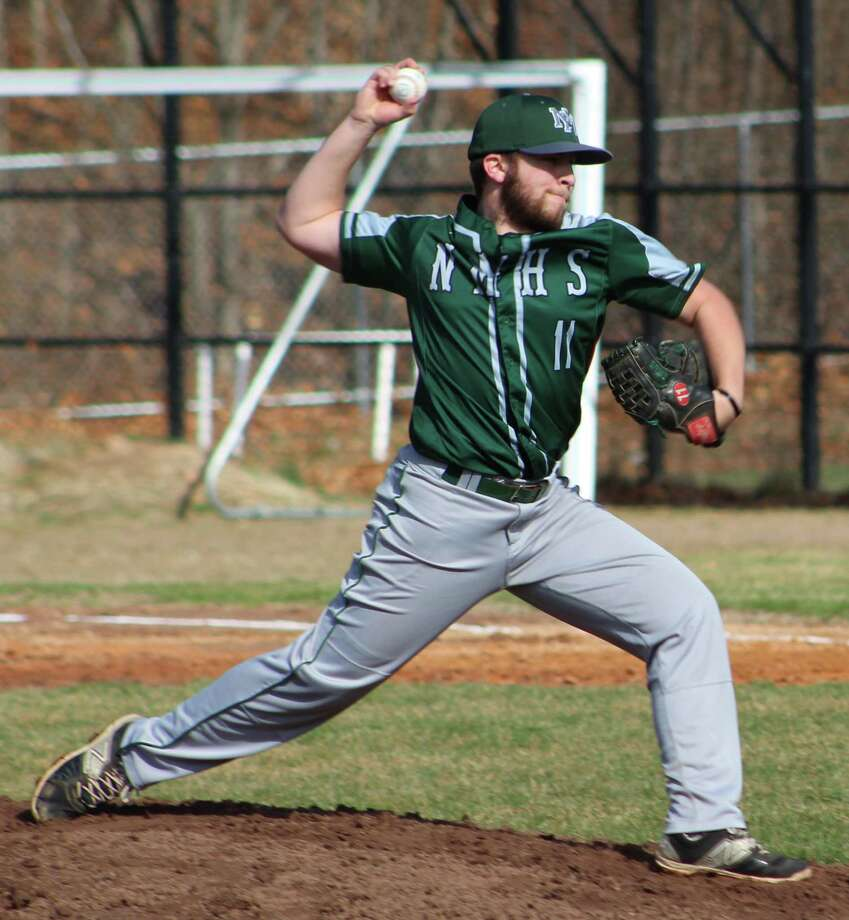 New Milford's Gavin Titus fires a pitch during the baseball game at Abbott Tech in Danbury April 5, 2017. Photo: Richard Gregory / Richard Gregory