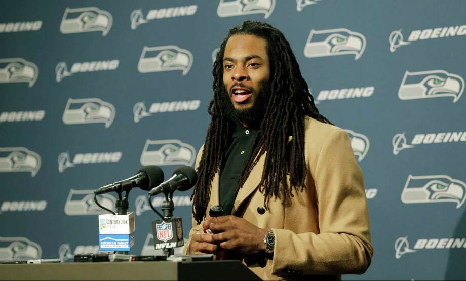 FILe - In this Jan. 7, 2017, file photo, Seattle Seahawks cornerback Richard Sherman talks to reporters following an NFL football NFC wild card playoff game against the Detroit Lions, in Seattle. Seahawks general manager John Schneider acknowledged the team has listened to trade offers regarding cornerback Richard Sherman, but downplayed that a deal may actually happen. Schneider made his comments in an interview with KIRO-AM on Wednesday, April 5, 2017. (AP Photo/Stephen Brashear, File) ORG XMIT: NY161 Photo: Stephen Brashear / FR159797 AP