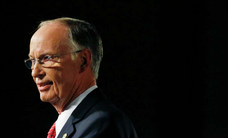 FILE - In this Tuesday, Feb. 7, 2017, file photo, Alabama Gov. Robert Bentley speaks during the annual State of the State address at the Capitol, in Montgomery, Ala.  The Alabama Ethics Commission could weigh in soon on whether there's reason to believe Bentley broke state law in a scandal that has engulfed him for a year. The commission is expected to go behind closed doors Wednesday, April 5  to consider the matter.   (AP Photo/Brynn Anderson, File) Photo: Brynn Anderson, STF / Copyright 2017 The Associated Press. All rights reserved.