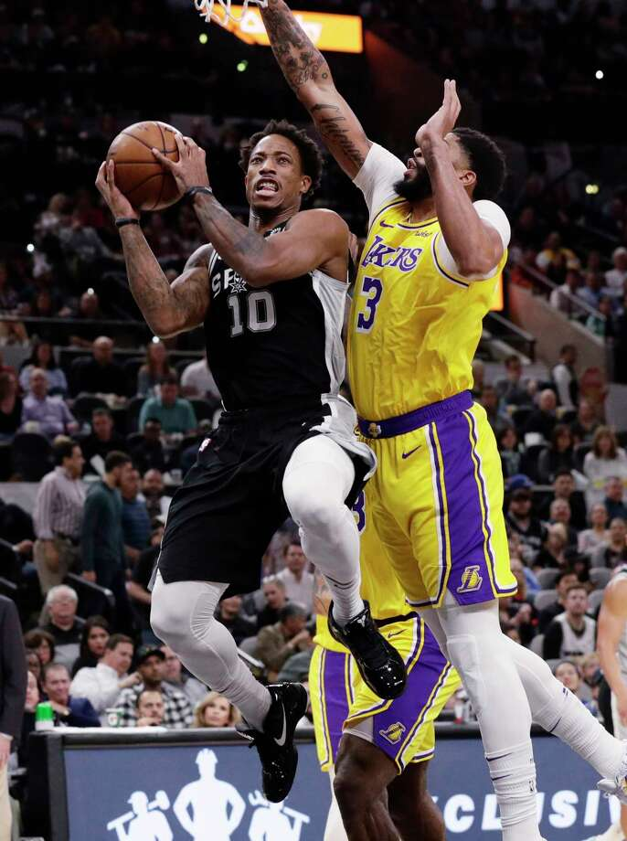 San Antonio Spurs guard DeMar DeRozan (10) shoots past Los Angeles Lakers forward Anthony Davis (3) during the first half of an NBA basketball game, in San Antonio, Monday, Nov. 25, 2019. (AP Photo/Eric Gay) Photo: Eric Gay, Associated Press / Copyright 2019 The Associated Press. All rights reserved.