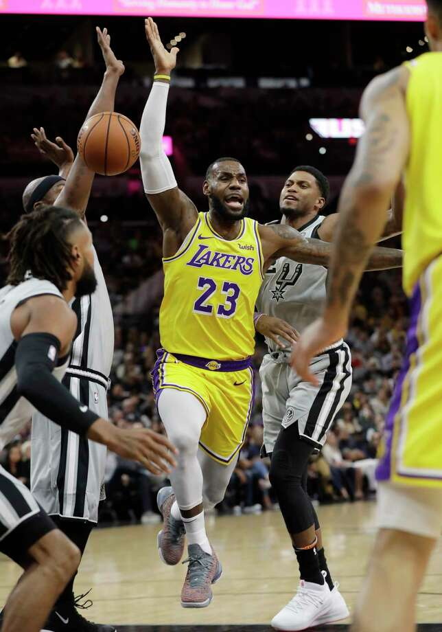 Los Angeles Lakers guard Tyler Ennis (11) drives against San Antonio Spurs guard Tony Parker, of France, during the first half of an NBA basketball game, Wednesday, April 5, 2017, in San Antonio. (AP Photo/Darren Abate) Photo: Darren Abate, Associated Press / FR115 AP