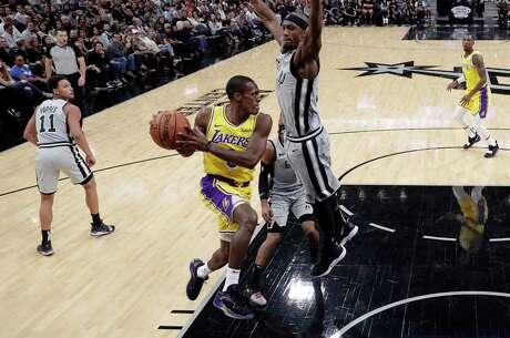 Los Angeles Lakers guard Jordan Clarkson (6) shoots against San Antonio Spurs center Dewayne Dedmon during the first half of an NBA basketball game, Wednesday, April 5, 2017, in San Antonio. (AP Photo/Darren Abate) Photo: Darren Abate, Associated Press / FR115 AP