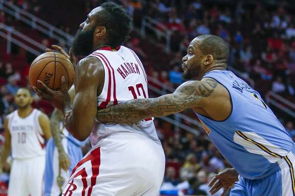 Houston Rockets guard James Harden (13) is fouled by Denver Nuggets guard Jameer Nelson (1) as he drives to the basket as the Houston Rockets take on the Denver Nuggets at the Toyota Center Wednesday, April 5, 2017 in Houston. ( Michael Ciaglo / Houston Chronicle)