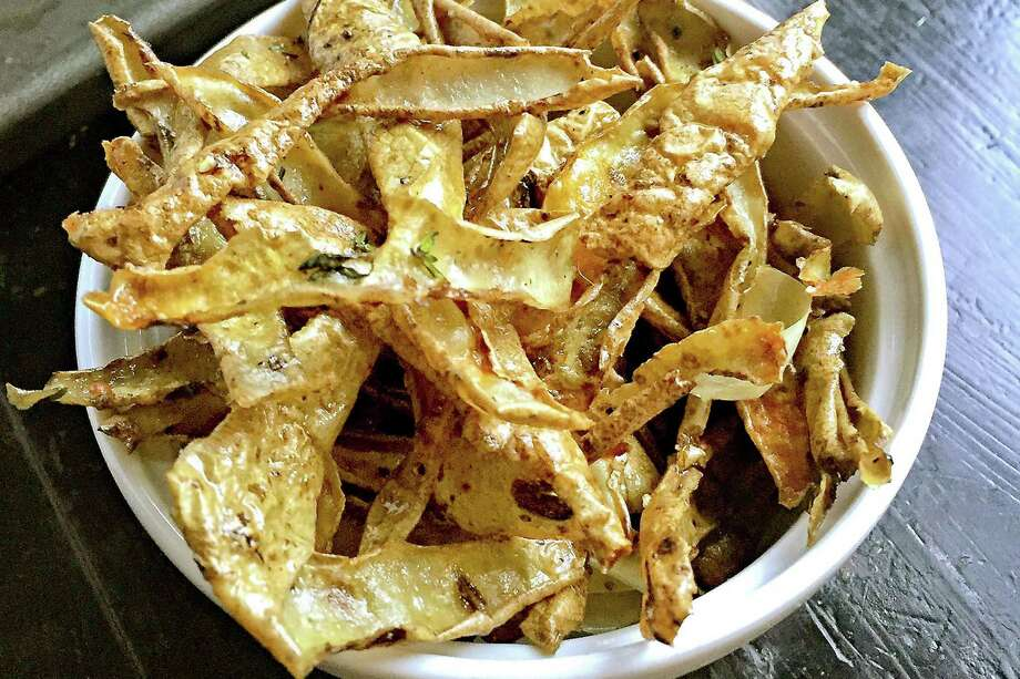 "Potato peel ""croutons"" are a terrific snack tossed with a little olive oil and fresh thyme. Photo: Gretchen McKay, MBR / Pittsburgh Post-Gazette"