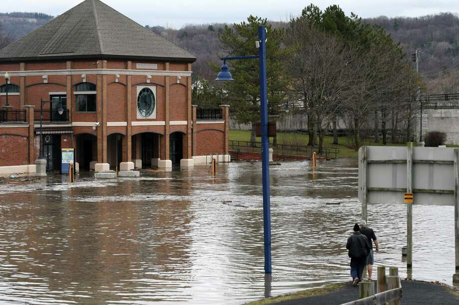 High waters are seen near the Waterford Harbor Visitors Center, background, on Wednesday, April 5, 2017, in Waterford, N.Y. Runoff from days of rain and melting snow were causing rivers to rise around the Capital Region and minor flooding was happening in low-lying parts of Troy, Watervliet and Waterford. (Will Waldron/Times Union) Photo: Will Waldron / 20040164A