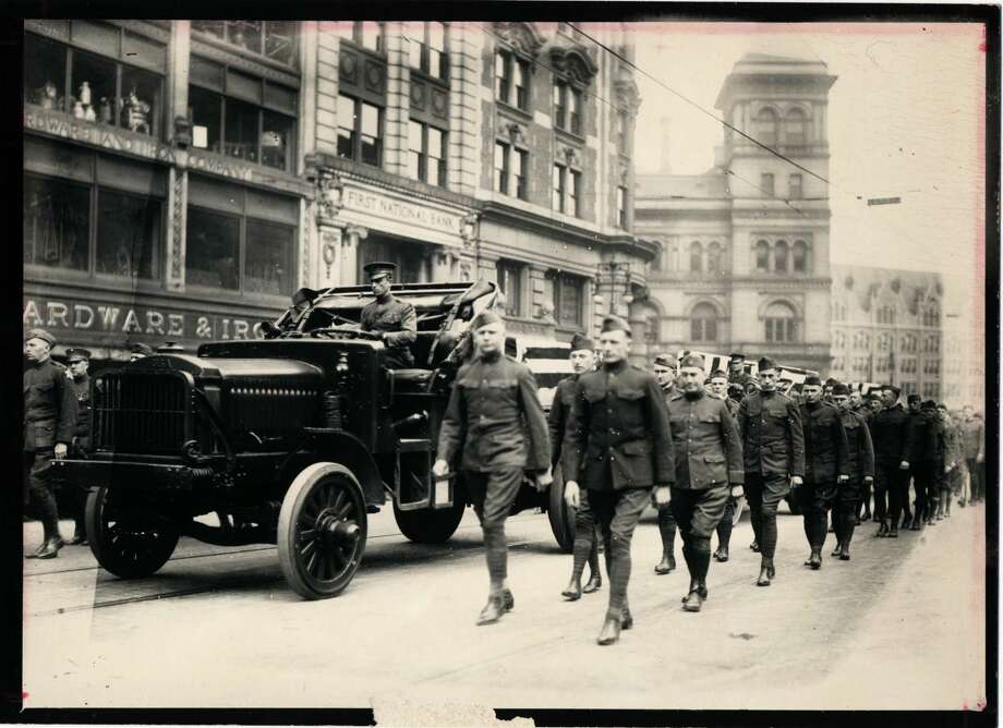 Local World War I veterans march on Albany's State Street and Broadway in 1918. (Times Union archive) Photo: UNKNOWN / TIMES UNION