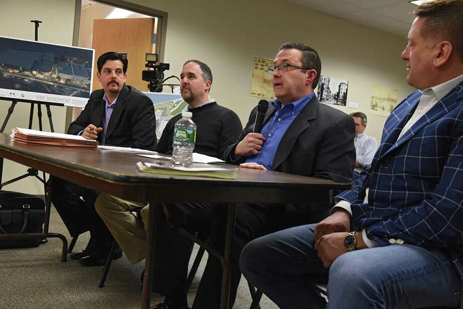 From left, Christiano Pereira of CPAArchitecture, Larry Novik of Bonacio Construction Inc., Joesph Masher of Bow Tie Bonacio Construction and Bow Tie Cinemas and Sonny Bonacio of Bonacio Construction Inc. presents a proposed square movie theater project to the City Council Planning and Economic Development Committee at City Hall Wednesday, April 5, 2017 in Troy, N.Y. (Lori Van Buren / Times Union) Photo: Lori Van Buren / 20040157A