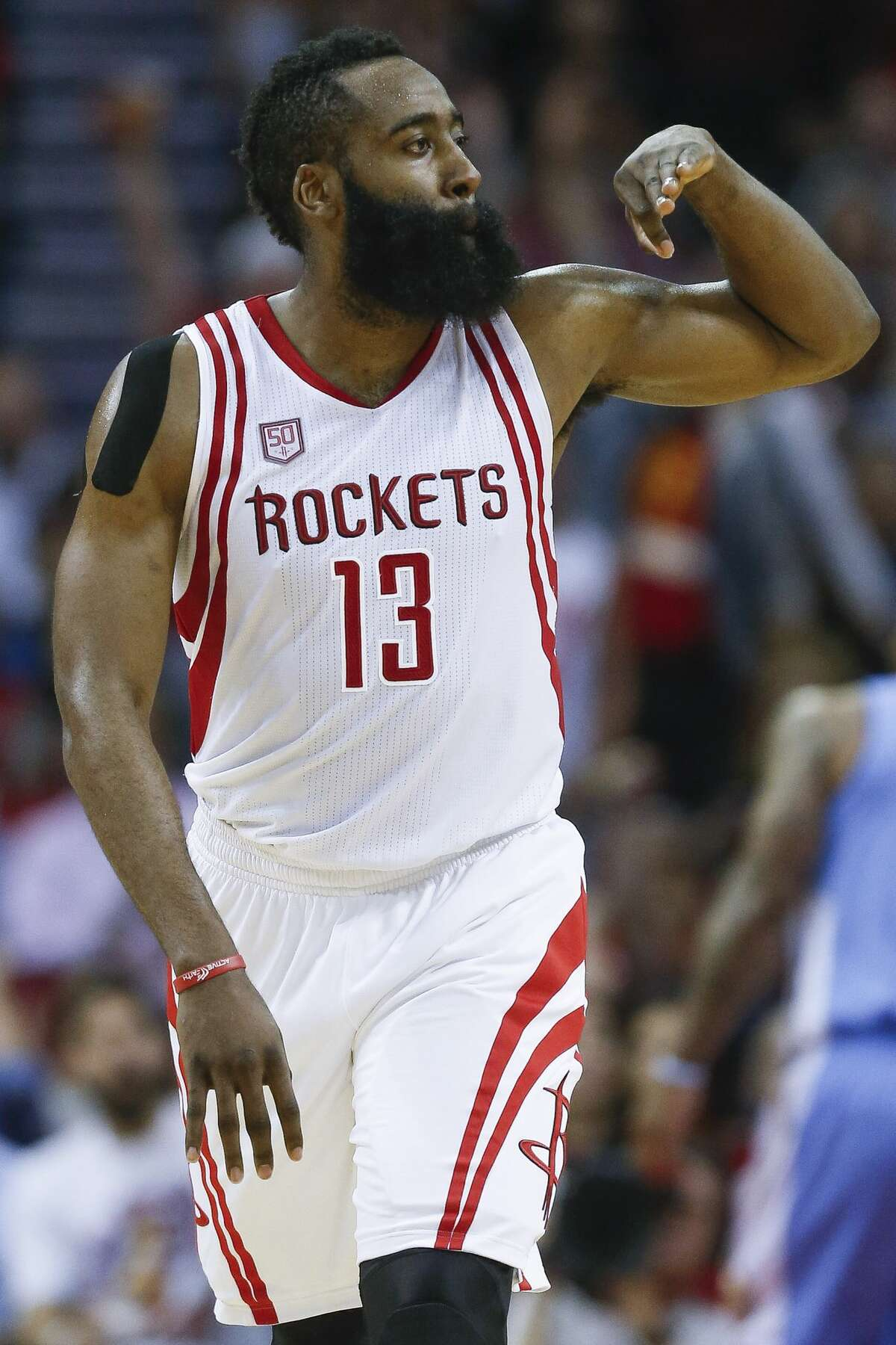 Houston Rockets guard James Harden (13) celebrates after hitting a three pointer as the Houston Rockets beat the Denver Nuggets 110-104 at the Toyota Center Wednesday, April 5, 2017 in Houston. ( Michael Ciaglo / Houston Chronicle)