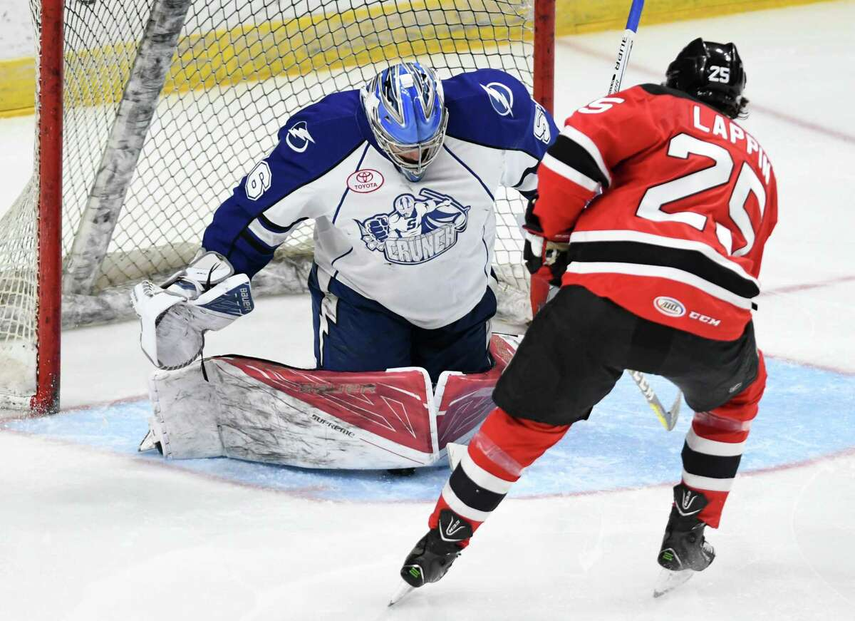 Albany Devils' Nick Lappin gets a shot past Syracuse Crunch goalie Mike McKenna to score his second goal during a hockey game at the Times Union Center Wednesday, April 5, 2017 in Albany, N.Y. (Lori Van Buren / Times Union)
