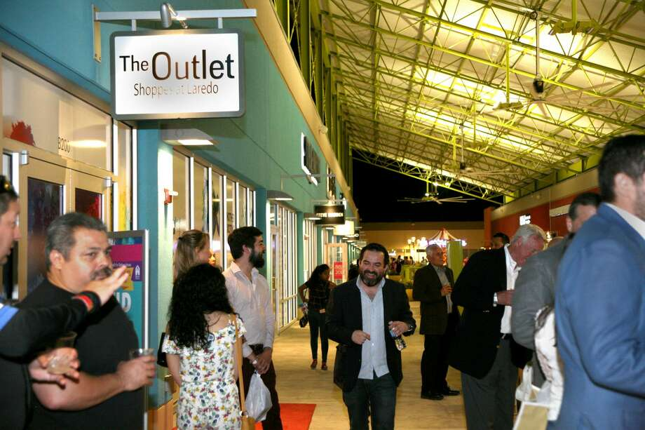 Attendees of the Open Doors, Open Hearts charity event at the Outlet Shoppes of Laredo enjoy an evening of fashion, music and socialization. Photo: Francisco Vera / Staff Photographer