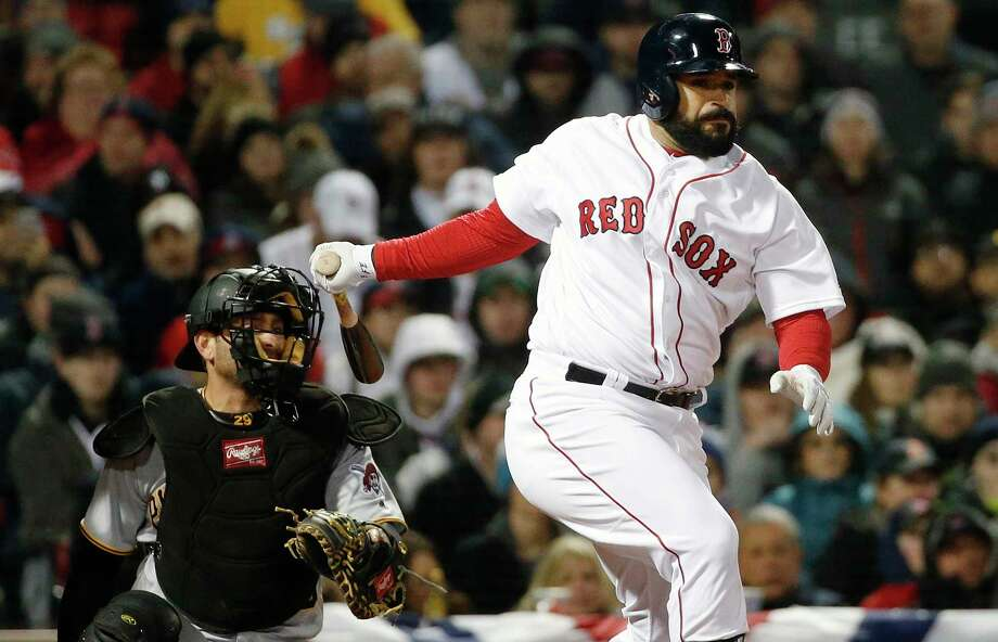 Boston Red Sox's Sandy Leon follows through on a double in front of Pittsburgh Pirates' Francisco Cervelli during the third inning of a baseball game in Boston, Wednesday, April 5, 2017. (AP Photo/Michael Dwyer) ORG XMIT: MAMD105 Photo: Michael Dwyer / Copyright 2017 The Associated Press. All rights reserved.