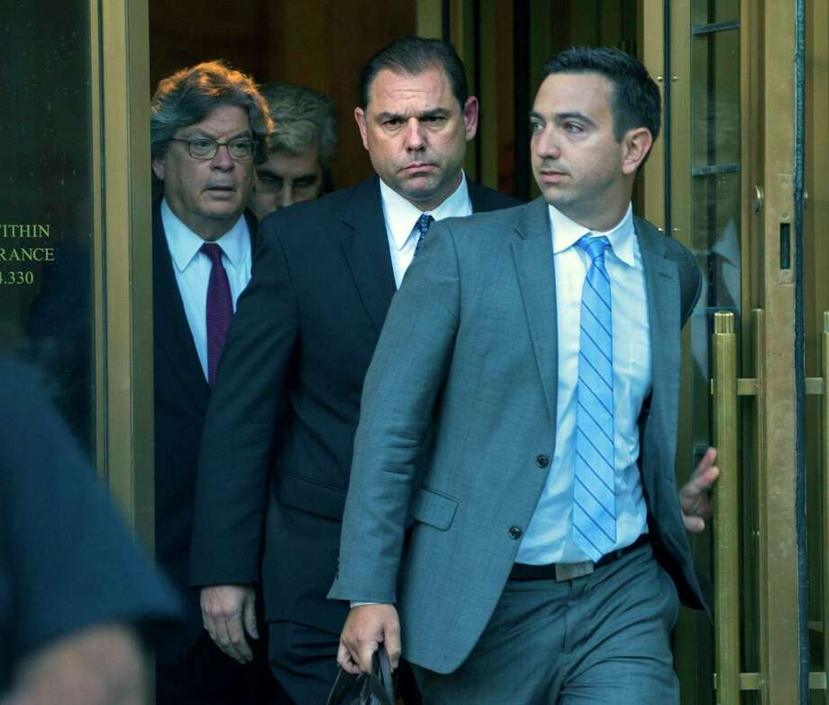 Joe Percoco, center, a former top advisor to Gov. Andrew Cuomo, leaves federal court in New York Thursday, Sept. 22, 2016. Federal authorities accused Percoco of soliciting more than $300,000 in bribes from an energy company and a Syracuse developer. (AP Photo/Craig Ruttle) ORG XMIT: NYCR101 Photo: Craig Ruttle / FR61802 AP