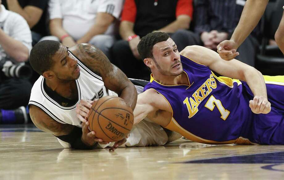 Spurs' LaMarcus Aldridge (12) and Los Angeles Lakers' Larry Nance, Jr. (07) fall to the floor for a loose ball during their game at the AT&T Center on Wednesday, Apr. 5, 2017. (Kin Man Hui/San Antonio Express-News) Photo: Kin Man Hui, Staff / San Antonio Express-News / ©2017 San Antonio Express-News