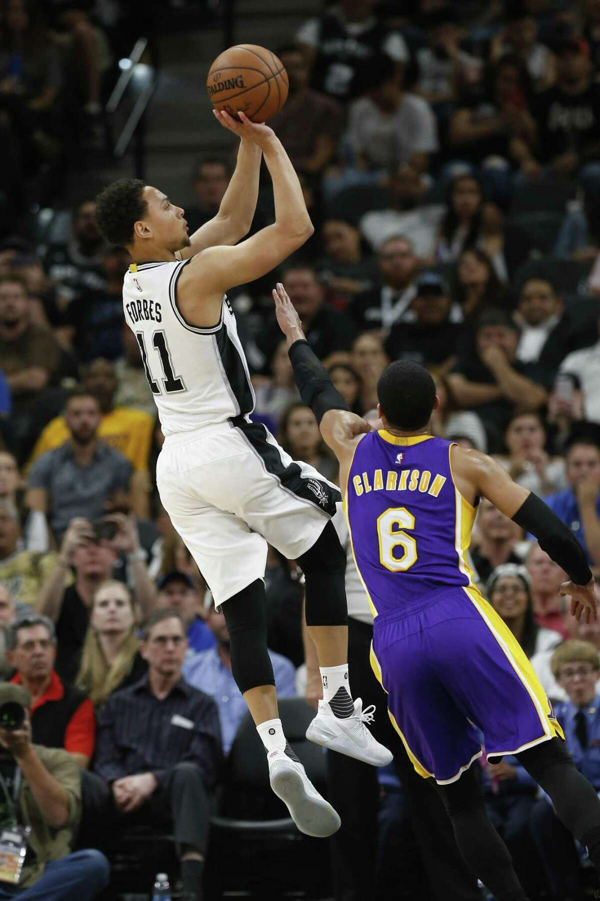Spurs' Bryn Forbes shoots against the Los Angeles Lakers' Jordan Clarkson (6) during their game at the AT&T Center on April 5, 2017.