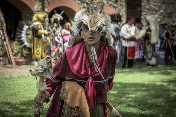 "Local actor Jesse Borrego, in the role of ""Coyote Man,"" performs along with the American Indians in Texas Dance Theater during the 6th Annual Four Seasons Indian Market at Mission Espada on Saturday, July 18, 2015. The recent designation of the Missions of San Antonio as a UNESCO World Heritage Site is raising awareness of the indigenous people of the Spanish colonial missions and their history."