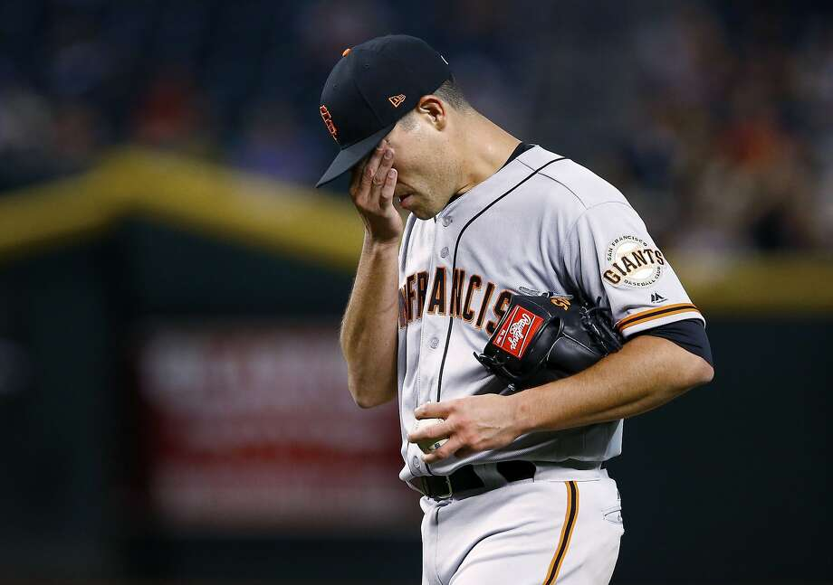 San Francisco Giants' Matt Moore wipes his face as he pauses on the mound on his way to giving up three runs during the fifth inning of the team's baseball game against the Arizona Diamondbacks on Wednesday, April 5, 2017, in Phoenix. (AP Photo/Ross D. Franklin) Photo: Ross D. Franklin, Associated Press