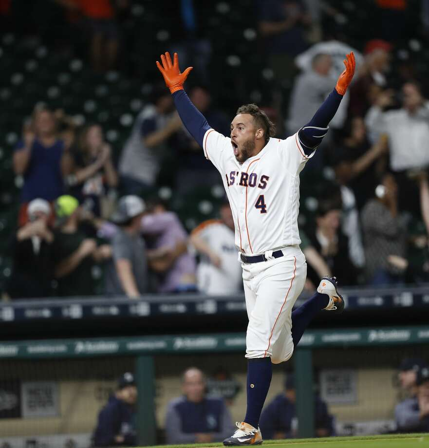 Houston Astros right fielder George Springer (4) celebrates his game winning home run in the thirteenth inning of an MLB baseball game at Minute Maid Park, Wednesday, April 5, 2017, in Houston.   ( Karen Warren / Houston Chronicle ) Photo: Karen Warren/Houston Chronicle
