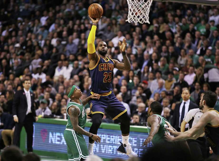 Cleveland Cavaliers forward LeBron James (23) shoots over Boston Celtics guard Isaiah Thomas during the second quarter of an NBA basketball game in Boston, Wednesday, April 5, 2017. (AP Photo/Charles Krupa) Photo: Charles Krupa / Associated Press / Copyright 2017 The Associated Press. All rights reserved.