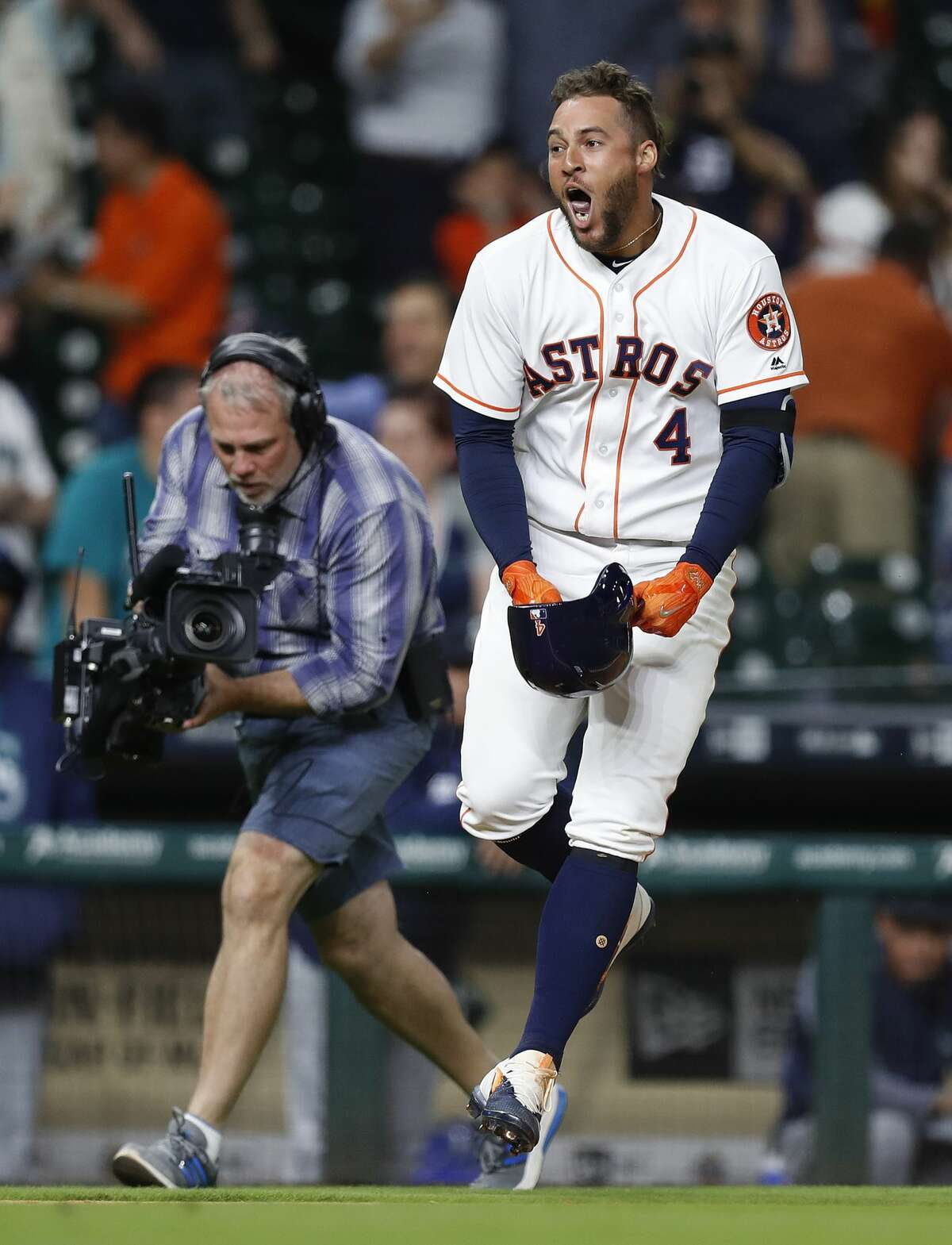 Houston Astros right fielder George Springer (4) celebrates his game winning home run in the thirteenth inning of an MLB baseball game at Minute Maid Park, Wednesday, April 5, 2017, in Houston. ( Karen Warren / Houston Chronicle )