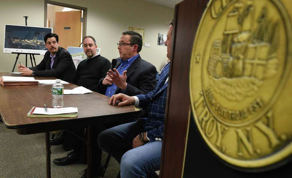 From left, Christiano Pereira of CPAArchitecture, Larry Novik of Bonacio Construction Inc., Joesph Masher of Bow Tie Bonacio Construction and Bow Tie Cinemas and Sonny Bonacio of Bonacio Construction Inc. presents a proposed square movie theater project to the City Council Planning and Economic Development Committee at City Hall Wednesday, April 5, 2017 in Troy, N.Y. (Lori Van Buren / Times Union)