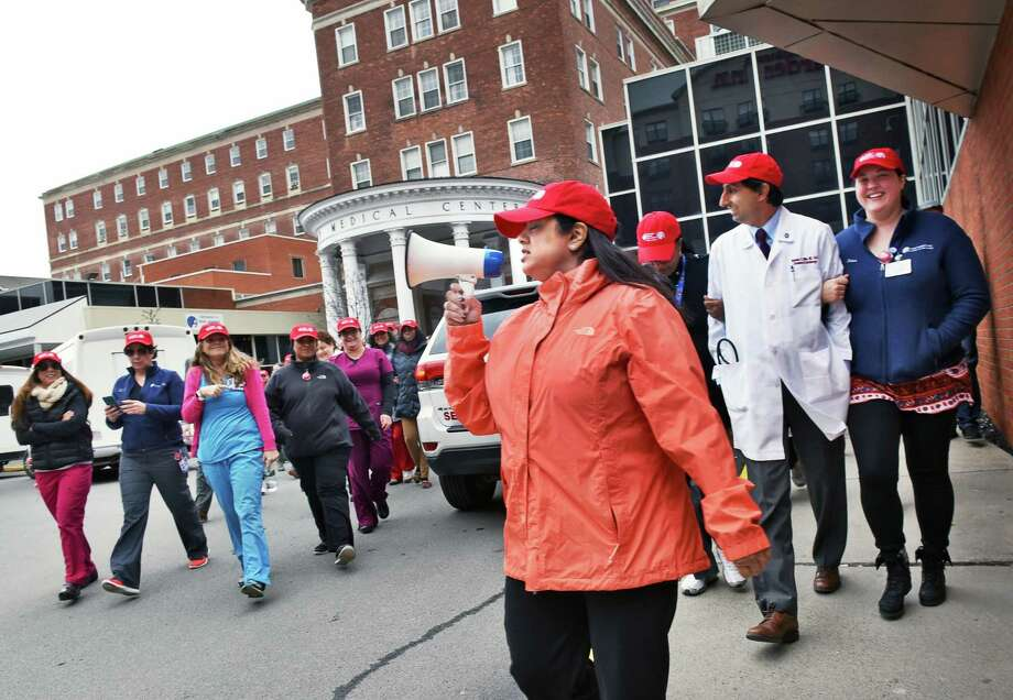 Cardiologist Dr. Suzie Mookherjee, center, leads Albany Medical Center staff as they partners with the American Heart Association for a walk through the Park South neighborhood for National Walking Day Wednesday April 5, 2017 in Albany, NY.  (John Carl D'Annibale / Times Union) Photo: John Carl D'Annibale / 20040133A