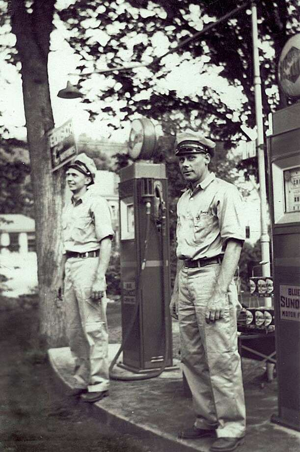 "Service stations, garages, gas pumps, car dealers and mechanics play an important role in a community. Over the years, many local garages began as carriage shops operated by blacksmiths and switched to auto repair as the mode of transportation transitioned from horse-drawn carriages to the automobile. Above, Stanley and Elmer Gunnarson stand at the gas pumps in front of Gunnarson's Garage on School Street in Washington Depot circa 1932. If you have a ""Way Back When"" photo to share, contact Deborah Rose at drose@newmilford.com or call 860-355-7324. Photo: Courtesy Of Gunn Historical Museum / The News-Times Contributed"