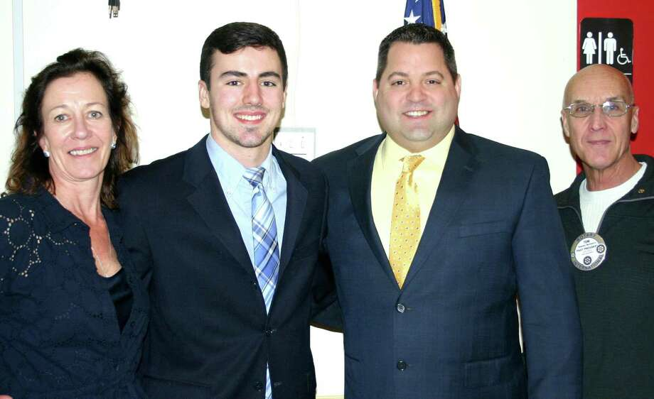The New Milford Rotary Club recently presented its February 2017 Student of the Month award to Sam Maniscalco, a senior at New Milford High School. Tom is an honor student, winner of the Xerox Award for Innovation and Technology and a member of the SWC All-Academic Team. His is captain of the varsity football team and a HOBY Scholar. The senior plans to pursue a degree in international relations with a career goal of working in the U.S. State Department. He is shown above, second from left, with his mother, Keelin Maniscalco, NMHS teacher Kevin Best and Rotarian Tom McSherry. Photo: Courtesy Of Rotary Club Of New Milford / The News-Times Contributed