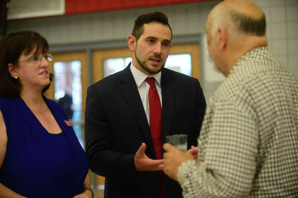 J.R. Romano, State GOP chairman and Derby native chats with Ed Greenberg and Congretional candidate Daria Novak at the Trump Rally at Sacred Heart University Saturday, August 13, 2016 in Fairfield, Conn.