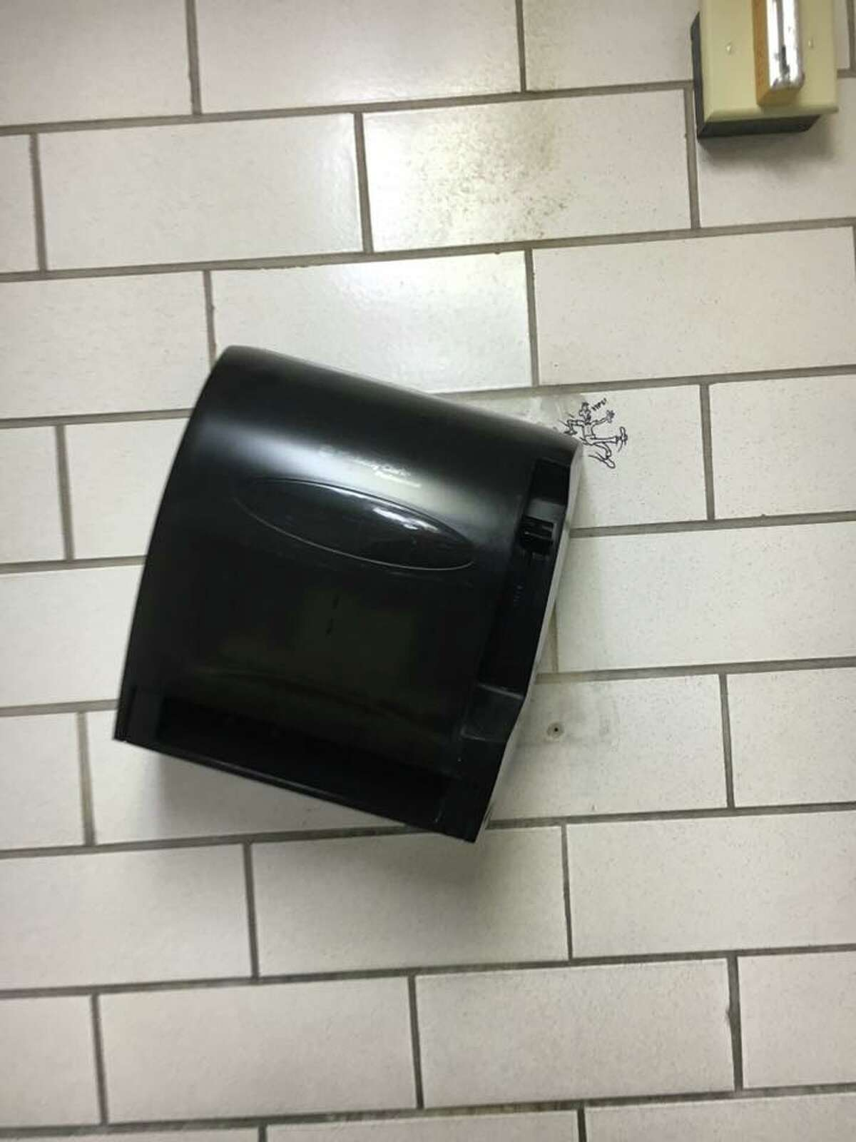 Angled paper towel dispenser.