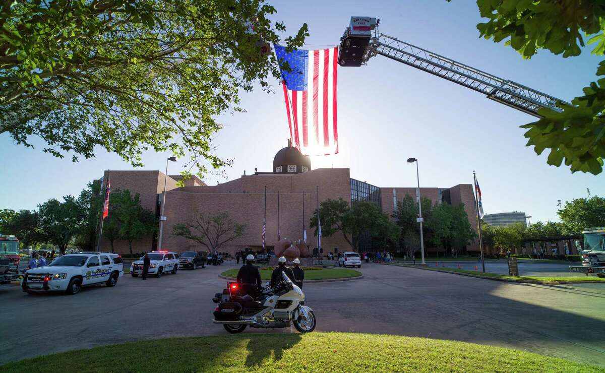 The body of Harris County Precinct 3 Assistant Chief Deputy Constable Clinton Greenwood arrives at the Second Baptist Church Thursday, April 6, 2017, in Houston.