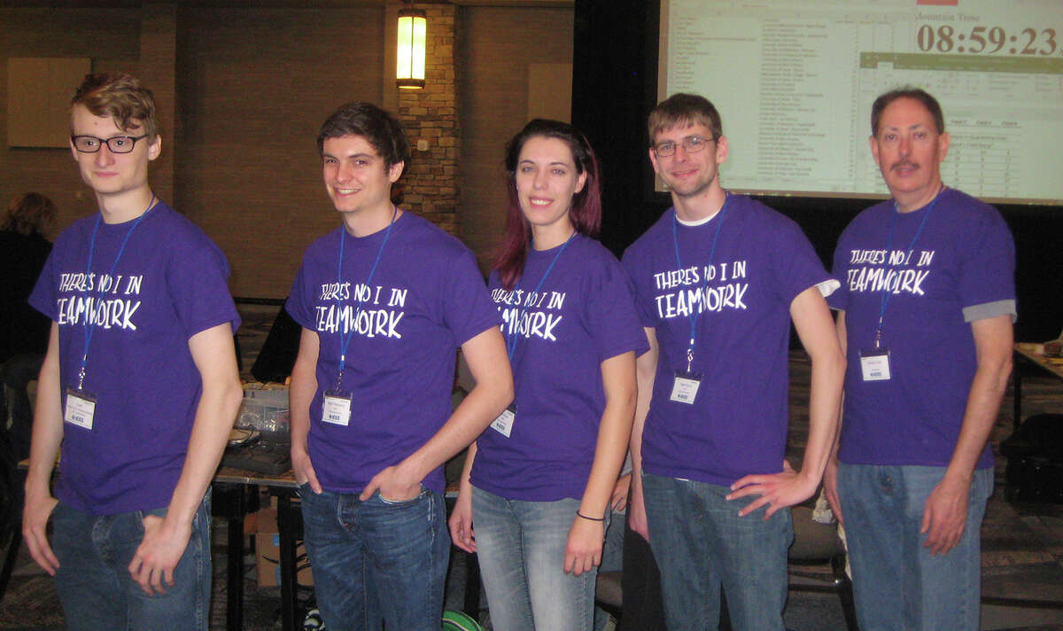 SIUE's team comprising (L-R) St. Louis native Oren Pincock, Scott Thompson, of Florissant, Mo., Lydia Klaus, of Edwardsville, and Sean Hovey, of Springfield, stands alongside faculty advisor Dr. George Engel.