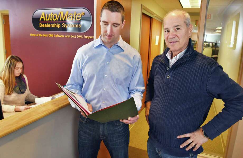 President and CEO Michael Esposito, right, and director of human resources Dave Druzynski in the Auto/Mate Dealership Systems offices Wednesday, March 15, 2017, in Colonie, N.Y.  (John Carl D'Annibale / Times Union) Photo: John Carl D'Annibale / 20039846A